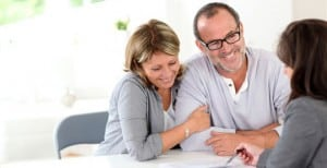 senior-couple-signing-financial-agreement1